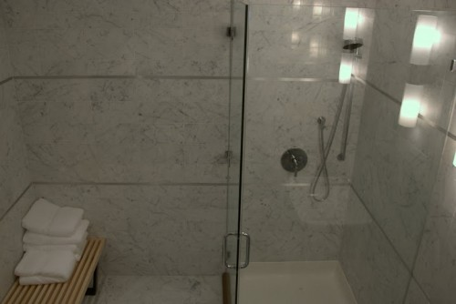 Marble shower. Nelson Platform Bench by Herman Miller